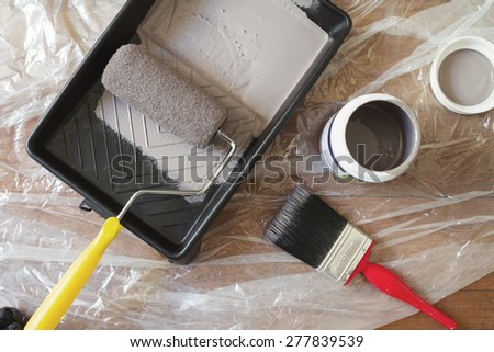 Overhead view of home painting equipment brush, roller, tray and paint pot - stock photo