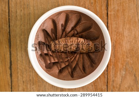 Overhead view of  homemade Chocolate Italian ice cream tub on wooden background , very shallow depth of field.  - stock photo