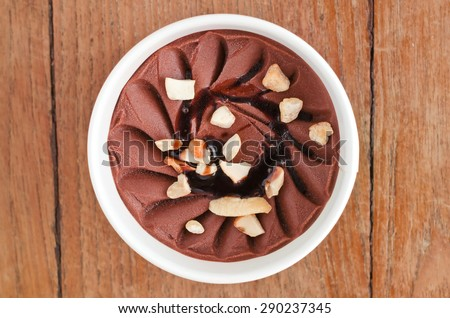 Overhead view of  homemade Walnut Italian ice cream tub on wooden background - stock photo