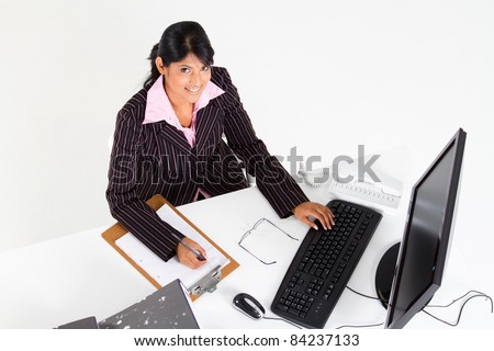 overhead view of indian businesswoman in office - stock photo