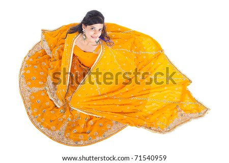 overhead view of Indian woman in traditional clothing sari - stock photo