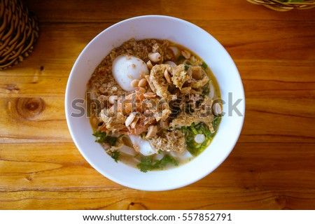 Overhead view of Mi Quang, traditional Central Vietnam Noodle dish for Breakfast, Lunch and Dinner, with Egg, Pork, Chicken and Shrimp