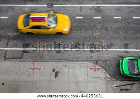 Overhead view of New York City street scene with Yellow taxi cab and green car
