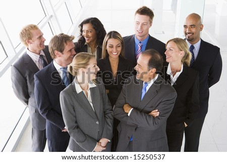 Overhead view of office staff chatting - stock photo