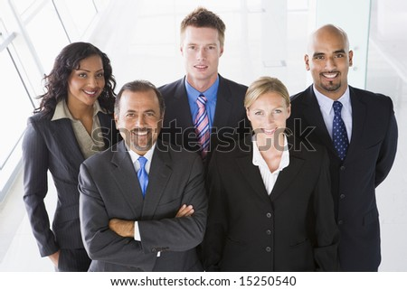 Overhead view of office staff looking to camera - stock photo