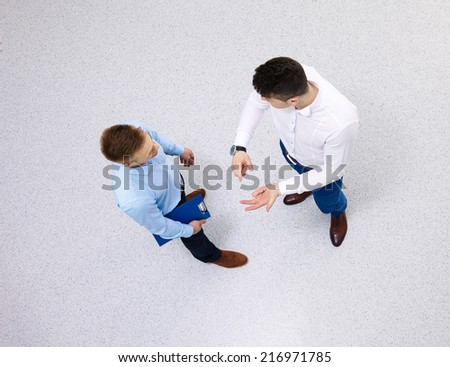 overhead view of people having business meeting - stock photo
