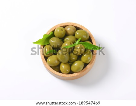 overhead view of pickled olives served in the wooden bowl - stock photo