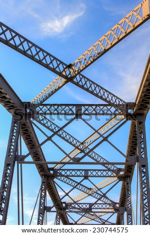 Overhead view of railroad bridge with blue sky and clouds - stock photo