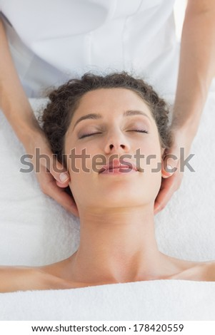 Overhead view of relaxed woman receiving massage in health spa - stock photo