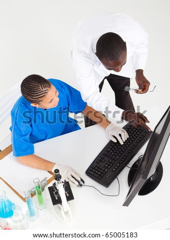 overhead view of two african american medical lab technicians working in lab - stock photo