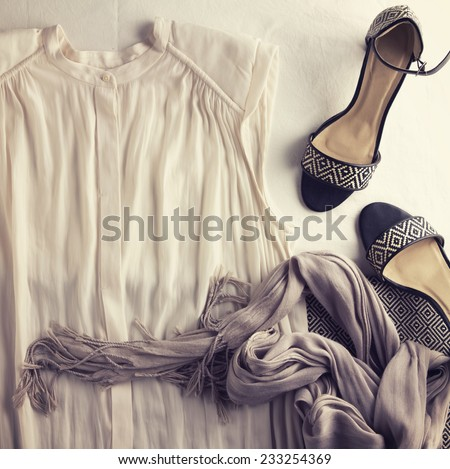 Overhead view of womens fashion shirt and accessories - stock photo