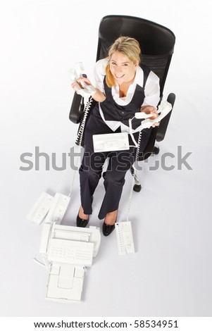 overhead view of young businesswoman with a lot telephones - stock photo