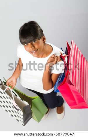 overhead view of young indian woman with shopping bags - stock photo