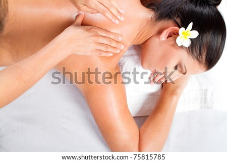 overhead view of young woman receiving back massage - stock photo