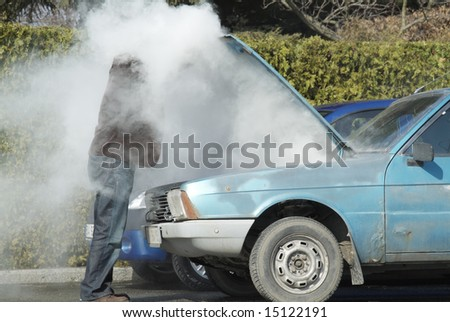 Overheated car - stock photo