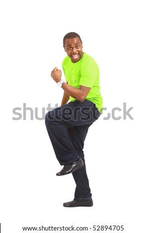 Overjoyed celebrating African American man on white background - stock photo