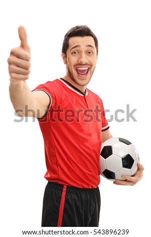 Overjoyed football player making a thumb up sign isolated on white background
