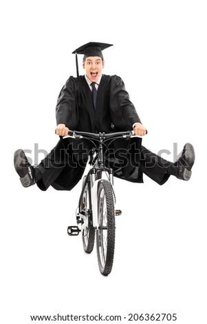 Overjoyed graduate student riding a bike isolated on white background - stock photo