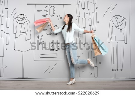 Overjoyed woman smiling after shopping