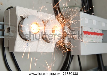 Overloaded electrical circuit causing fuse to break - stock photo