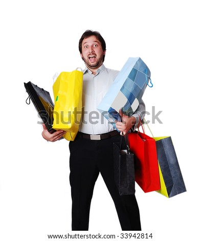 Overloaded man with shopping bags - stock photo