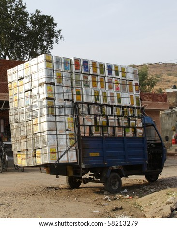 Overloaded truck in India - stock photo