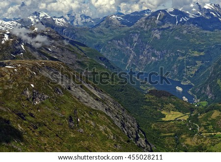 Overlook from cloud level on Mt. Dalsnibba of the beautiful Geiranger Fiord in Norway