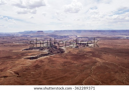 Overlook of the Green River and  the red rock mountains at Canyonslands National Park, Utah, USA - stock photo