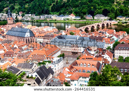 Overlook of the rooftops of the city of Heidelberg and the River Neckar from the ruins of Heidelberg Castle, Baden-Wurttemberg, Germany  - stock photo