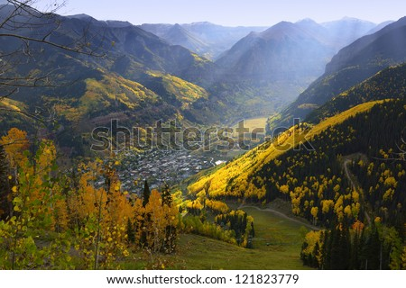 overlook over Telluride with golden, green and red aspen in Colorado - stock photo