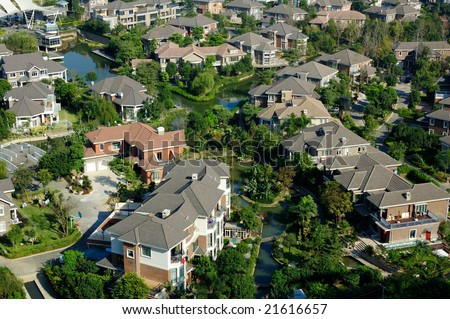 Overlooking a neighborhood of residential district with a river through - stock photo