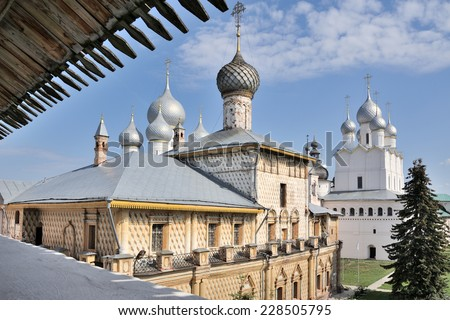 Overlooking churches of Rostov Kremlin from walking passage on western fortified wall: attractive Muscovite baroque church of Virgin Hodegetria (1692-1693) & church of Resurrection of Christ (1670) - stock photo