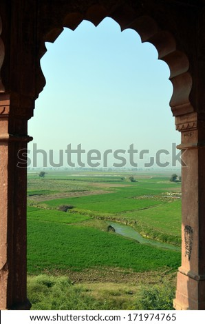 Overlooking green farms through open windows, perfect countryside natural green background - stock photo