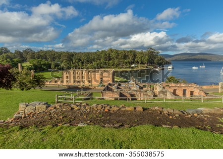 Overlooking guard tower and penitententiary from behind in Port Arthurs historic convict settlement, in the Tasman Peninsula, Tasmania, Australia. . - stock photo