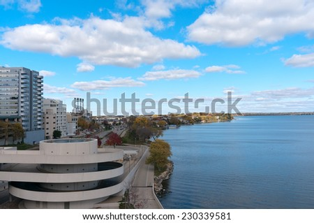 Overlooking Lake Monona and city in downtown Madison Wisconsin from Monona Terrace - stock photo