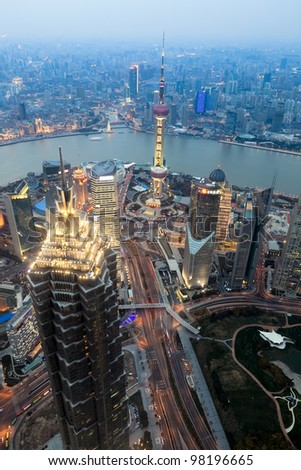 overlooking shanghai at dusk from shanghai world financial center - stock photo