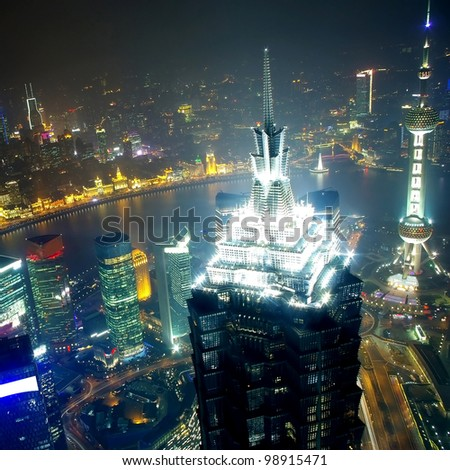 overlooking shanghai at night from shanghai world financial center  2012 - stock photo