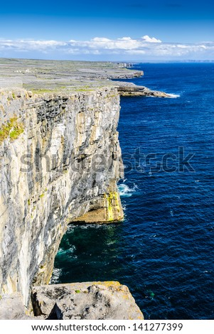 Overlooking the Atlantic ocean on the cliffs on Inishmore (Inis M�¢??r), Aran Islands, Ireland next to Dun Aonghasa fort. - stock photo