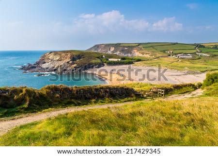 Overlooking the beach at Gunwalloe Church Cove Cornwall England UK Europe - stock photo