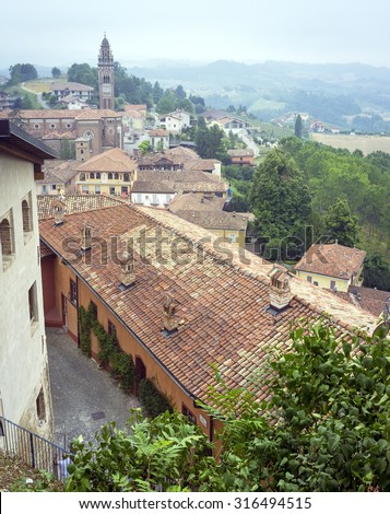 Overlooking the hills and vineyards of Barolo of the Langhe (Piedmont, Northern Italy), from the viewpoint of the town of Monforte d'Alba (Cuneo Province). Monforte d'Alba (Cuneo), July 2015. - stock photo