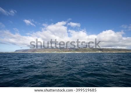 Overlooking the Kauai from the sea - stock photo
