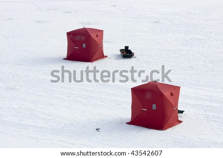 Overlooking two ice fishing tents on frozen lake in Utah - Pineview Reservoir - stock photo