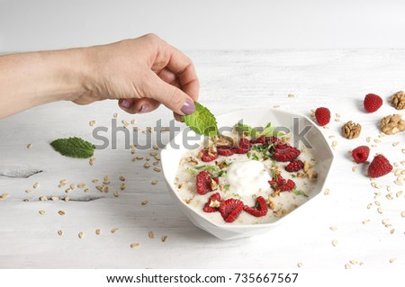 Overnight bircher muesli with walnuts, raspberry and mint.