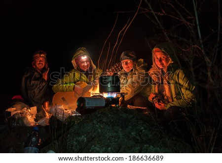 Overnight in tents near a fire - stock photo