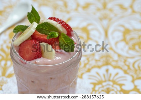 Overnight oatmeal smoothie with strawberry and banana in a jar - stock photo