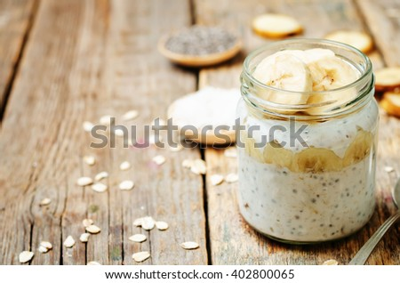overnight oats with Greek yogurt, Chia seeds and banana. toning. selective focus - stock photo