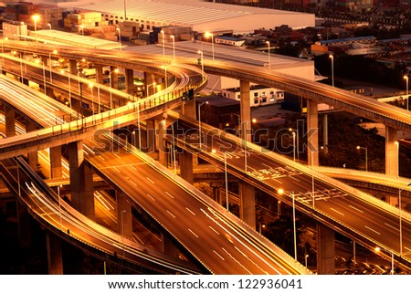 Overpass and pier at night - stock photo