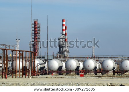 Overpass loading of oil products and fuel storage vessels. The equipment at the refinery. - stock photo
