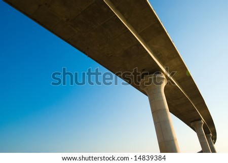 overpass on background of blue sky - stock photo