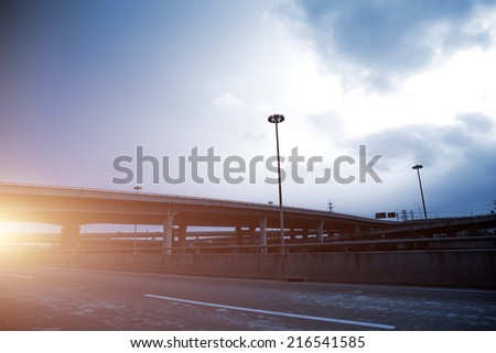 overpass over the road in modern city - stock photo